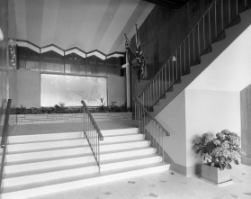 New Plymouth War Memorial interior. Ground floor memorial and staircase. Harvey and Bowering, War Memorial. Image: Swainson's Studios, Jan 1961. Swainson/Woods Collection, Puke Ariki and District Libraries