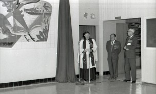 Church of England Archdeacon Vincent Venimore dedicates the mural at its unveiling on Anzac Day. Photographer unknown, 1966. Wairarapa Times-Age collection, Wairarapa Archive.
