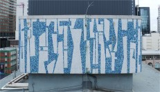 South profile of Guy Ngan's Bledisloe State Building penthouse frieze, 1956. Image: Aerialsmiths, courtesy of Auckland Council, 2019, edited by Bronwyn Holloway-Smith